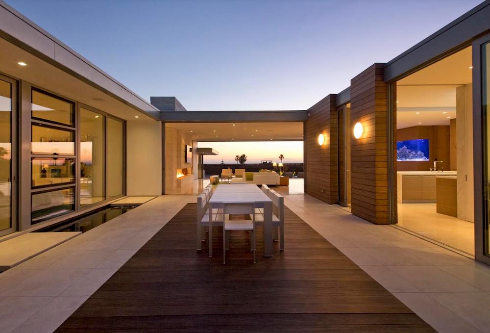 EYRC Architects Irvine Cove Residence interior courtyard night